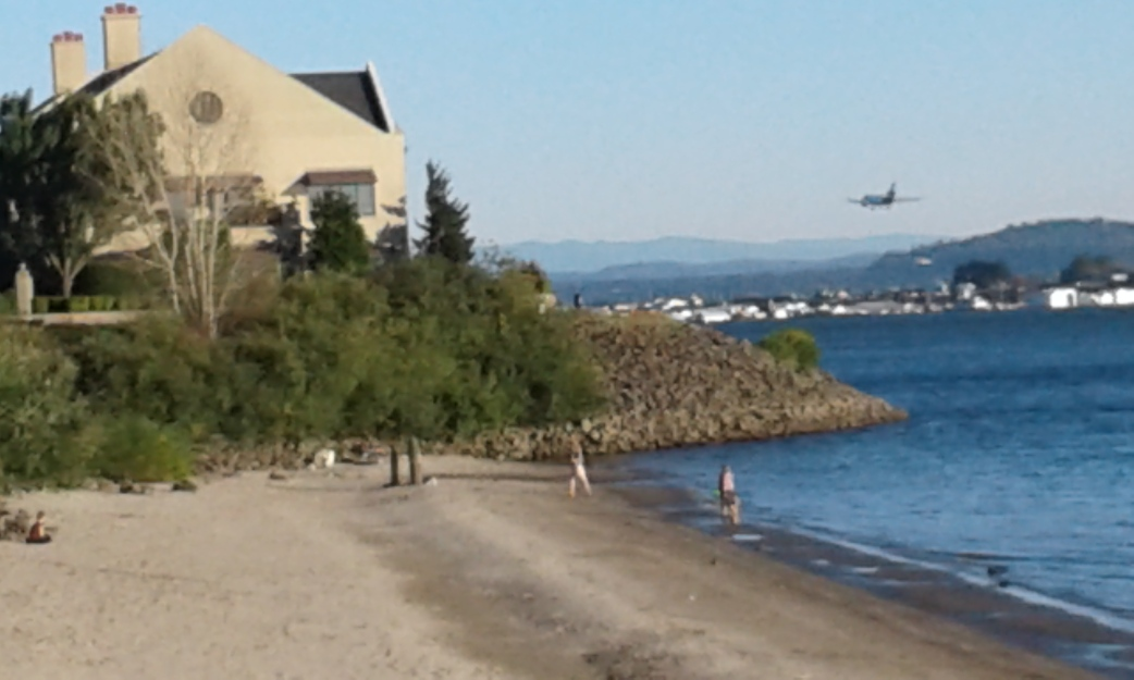 """Plane Landing"" near a Vancouver beach along Columbia, photo by Bea Garth copyright 2016"