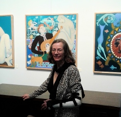 Bea Garth in front her painting The Music Genie, copyright 2018 at the Gallery @ Cerulean feb 2018