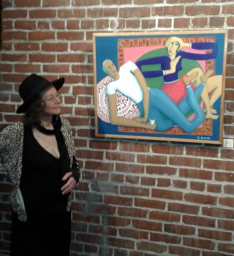 Bea Garth looking at her painting Legs Like Vines at the Gallery at the Cerulean Feb 2018